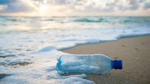 un happy about Plastic bottle on an eco beach holiday